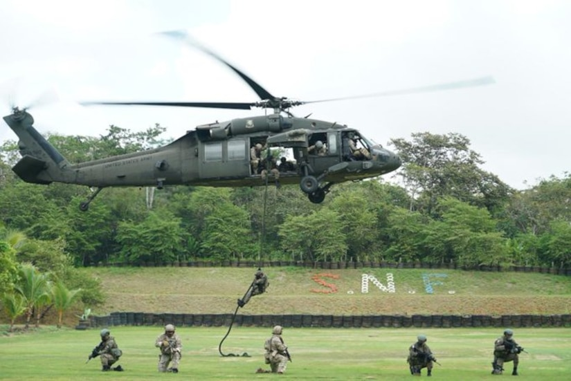 U.S. Army Soldiers assigned to Joint Task Force-Bravo and Panamanian service members conduct fast rope insertion/extraction system training during exercise Mercury in Panama.