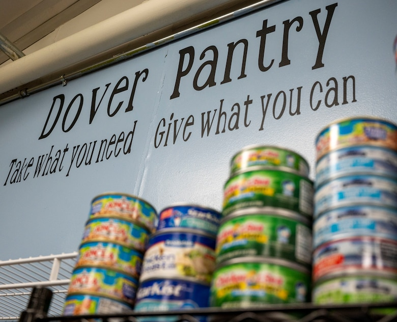 """Created by key spouses, Lynne Otis and Jessica Hammer, the Dover Food Pantry encourages Airmen to """"take what they need"""" and """"give what they can"""" at Dover Air Force Base, Delaware, Jan. 20, 2021. Located in the Airman's Attic, the food pantry was created by Otis and Hammer in an effort to alleviate financial burdens Airmen and their families may face during the COVID-19 pandemic. (U.S. Air Force photo by Airman 1st Class Cydney Lee)"""