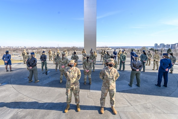 Lt. Gen. Mary F. O'Brien,deputy chief of staff for Intelligence, Surveillance, Reconnaissance and Cyber Effects Operations, and Chief Master Sgt. of the Air Force JoAnne S. Bass stand in front of a group of female Airmen demonstrating the Air Force's new hair policy for women in front of the Air Force Memorial Jan. 24. (US. Air Force photo by Master Sgt. Grant Langford)