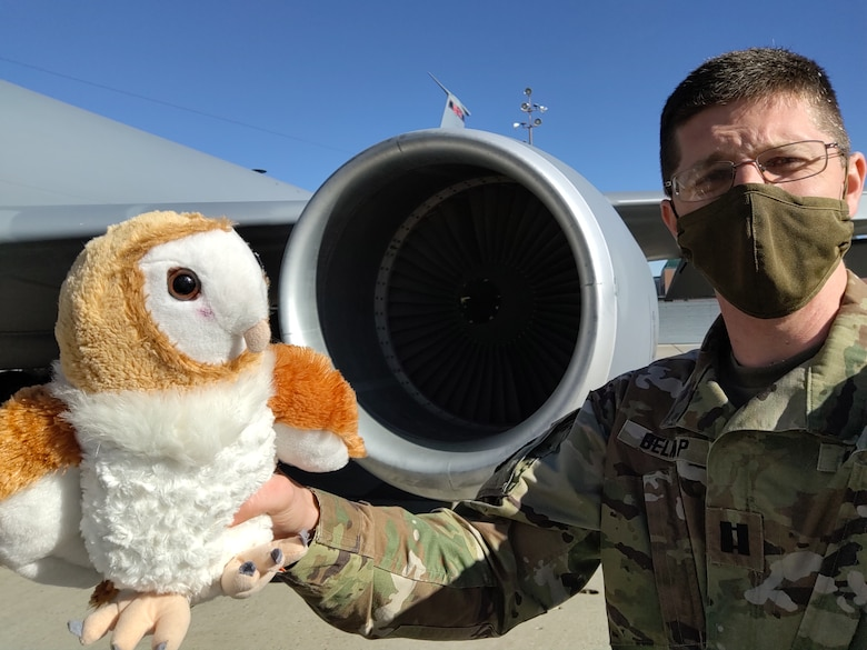Capt. Jeffrey Dallin Belnap has been carrying Jupiter with him in his backpack. When the opportunity presents itself, he pulls out the stuffed animal and snaps a photo.
