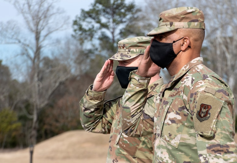 Commander of Air Force Reserve Command, Lt. Gen. Richard W. Scobee and AFRC's command chief master sergeant, Timothy C. White, salute the arrival of Air Force Chief of Staff, Gen. Charles Q. Brown Jr., to Air Force Reserve Command headquarters on Robins Air Force Base in Georgia on Feb. 8, 2021. While at the headquarters, Brown discussed COVID-19 response efforts, diversity and inclusion issues, readiness, and the role of the Air Force Reserve in the future fight. (U.S. Air Force photo by Master Sgt. Stephen D. Schester)