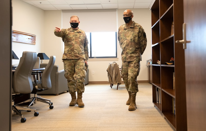 Commander of Air Force Reserve Command, Lt. Gen. Richard W. Scobee, gives Air Force Chief of Staff, Gen. Charles Q. Brown Jr., a tour of his office inside AFRC headquarters at Robins Air Force Base in Georgia on Feb. 8, 2021. While at the headquarters, Brown discussed COVID-19 response efforts, diversity and inclusion issues, readiness, and the role of the Air Force Reserve in the future fight. (U.S. Air Force photo by Master Sgt. Stephen D. Schester)