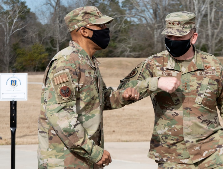 Air Force Chief of Staff, Gen. Charles Q. Brown Jr., bumps elbows with commander of Air Force Reserve Command, Lt. Gen. Richard W. Scobee, upon his arrival to AFRC headquarters on Robins Air Force Base in Georgia on Feb. 8, 2021. While at the headquarters, Brown discussed COVID-19 response efforts, diversity and inclusion issues, readiness, and the role of the Air Force Reserve in the future fight. (U.S. Air Force photo by Master Sgt. Stephen D. Schester)