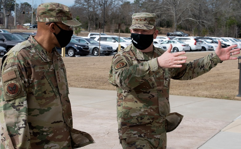 Commander of Air Force Reserve Command, Lt. Gen. Richard W. Scobee, guides Air Force Chief of Staff, Gen. Charles Q. Brown Jr., towards AFRC headquarters upon Brown's arrival to Robins Air Force Base in Georgia on Feb. 8, 2021. While at the headquarters, Brown discussed COVID-19 response efforts, diversity and inclusion issues, readiness, and the role of the Air Force Reserve in the future fight. (U.S. Air Force photo by Master Sgt. Stephen D. Schester)