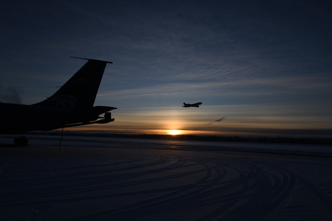 KC-135 Stratotankers from the 168th Wing take-off at Eielson Air Force Base with the arctic sunset as a back drop.