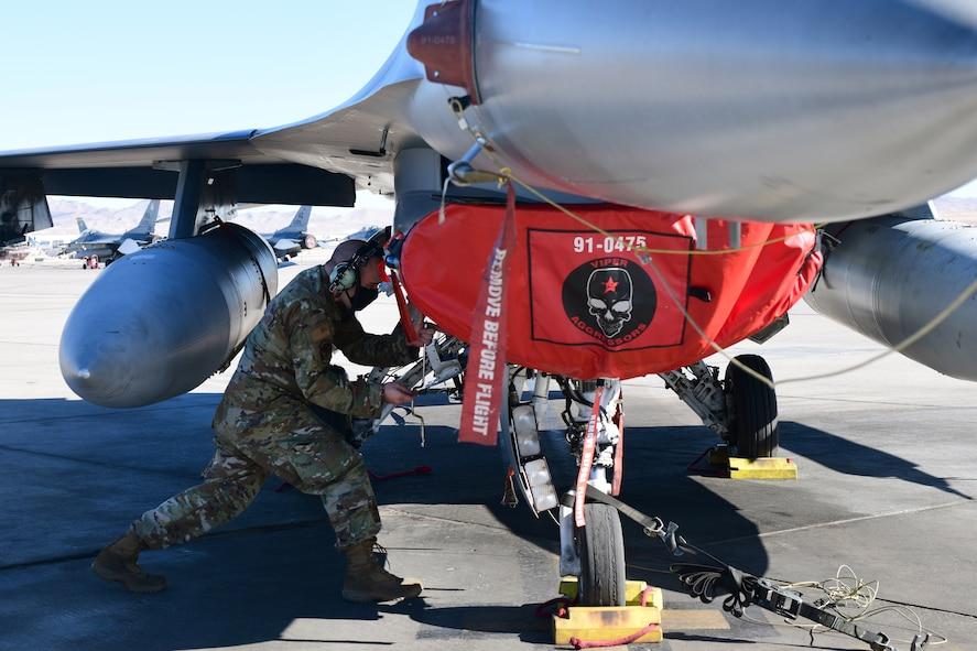 Staff Sgt. Scott Stump, 926th Aircraft Maintenance Squadron, works on an F-16, Feb. 6, at Nellis Air Force Base, Nevada.