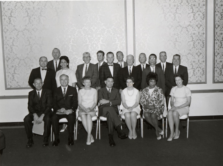 a group of people sitting and standing