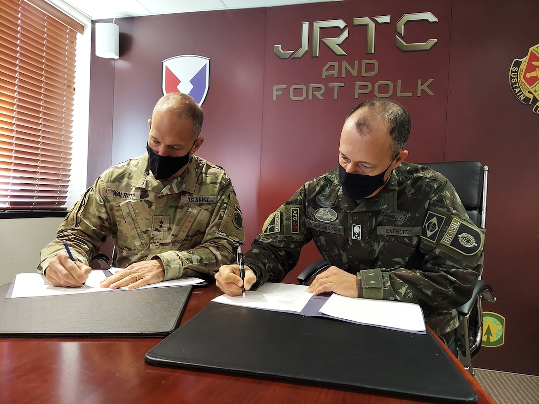 Maj. Gen. Daniel R. Walrath (left), Army South commanding general, and Lt. Gen. Marcos de Sá Affonso da Costa (right), chief of training, Land Forces Training Command, Exército Brasileiro, signs a technical arrangement between the Brazilian Army and the U.S. Army as represented by Army South concerning Brazilian participation in combined training exercise in conjunction with Joint Readiness Training Center Rotation 21-04 at Fort Polk, Louisiana, Feb. 1.