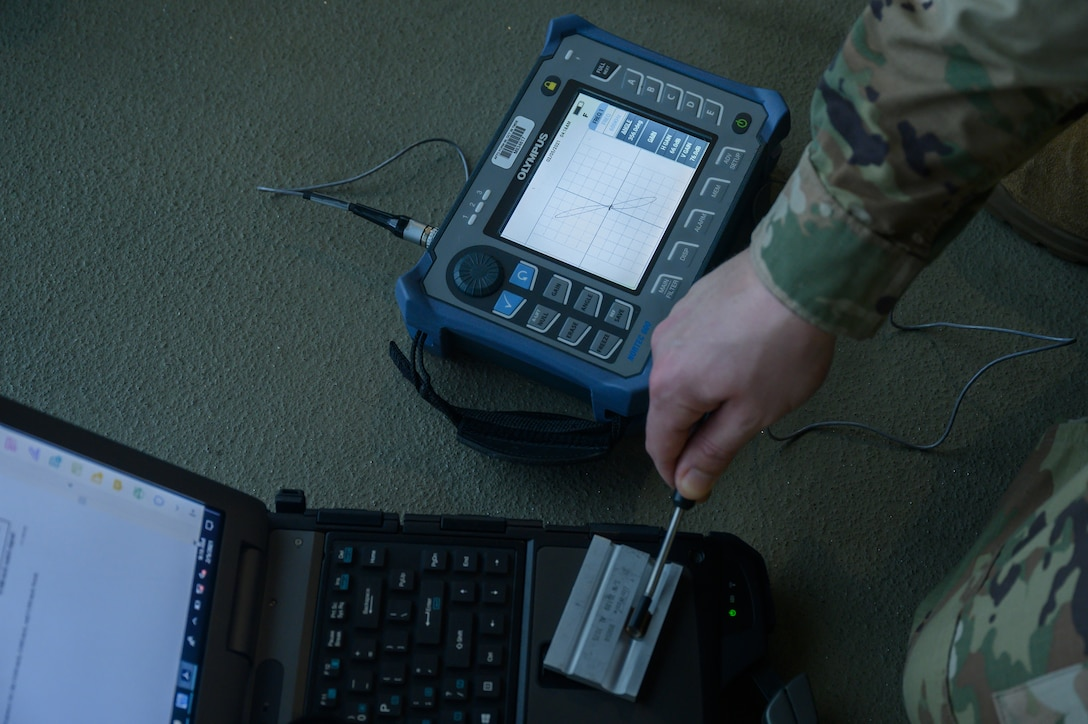 An Airman prepares an eddy current ribbon probe for inspection.