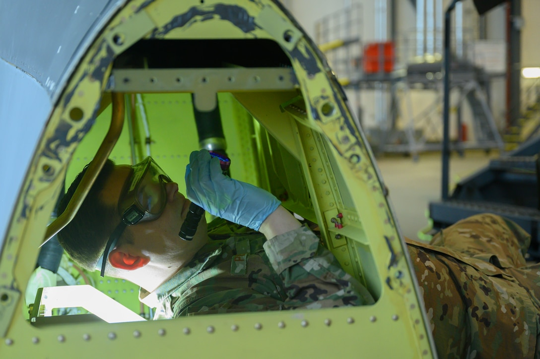 An Airman inspects the interior of a C-130.