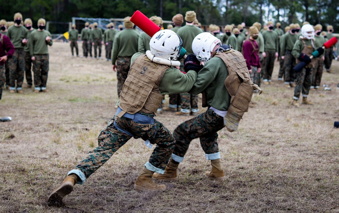 Recruits with Papa Company, 4th Recruit Training Battalion, conduct pugil sticks bouts aboard Marine Corps Recruit Depot Parris Island, S.C. Jan. 11, 2021. Pugil sticks help recruits practice the fundamentals of Marine Corps Martial Arts. (U.S. Marine Corps photo by Cpl. Dylan Walters)
