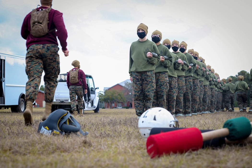 Recruits with Papa Company, 4th Recruit Training Battalion, prepare to conduct pugil sticks bouts aboard Marine Corps Recruit Depot Parris Island, S.C. Jan. 11, 2021. Pugil sticks help recruits practice the fundamentals of Marine Corps Martial Arts. (U.S. Marine Corps photo by Cpl. Dylan Walters)