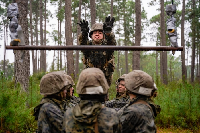 A recruit with Hotel Company, 2nd Recruit Training Battalion leaps to complete an obstacle during the Crucible Jan. 15, 2020 at Marine Corps Recruit Depot Parris Island, S.C. The Crucible is recruit training's 54-hour culminating event that involves food and sleep deprivation and the completion of myriad events for recruits to complete in order to claim the title United States Marine.