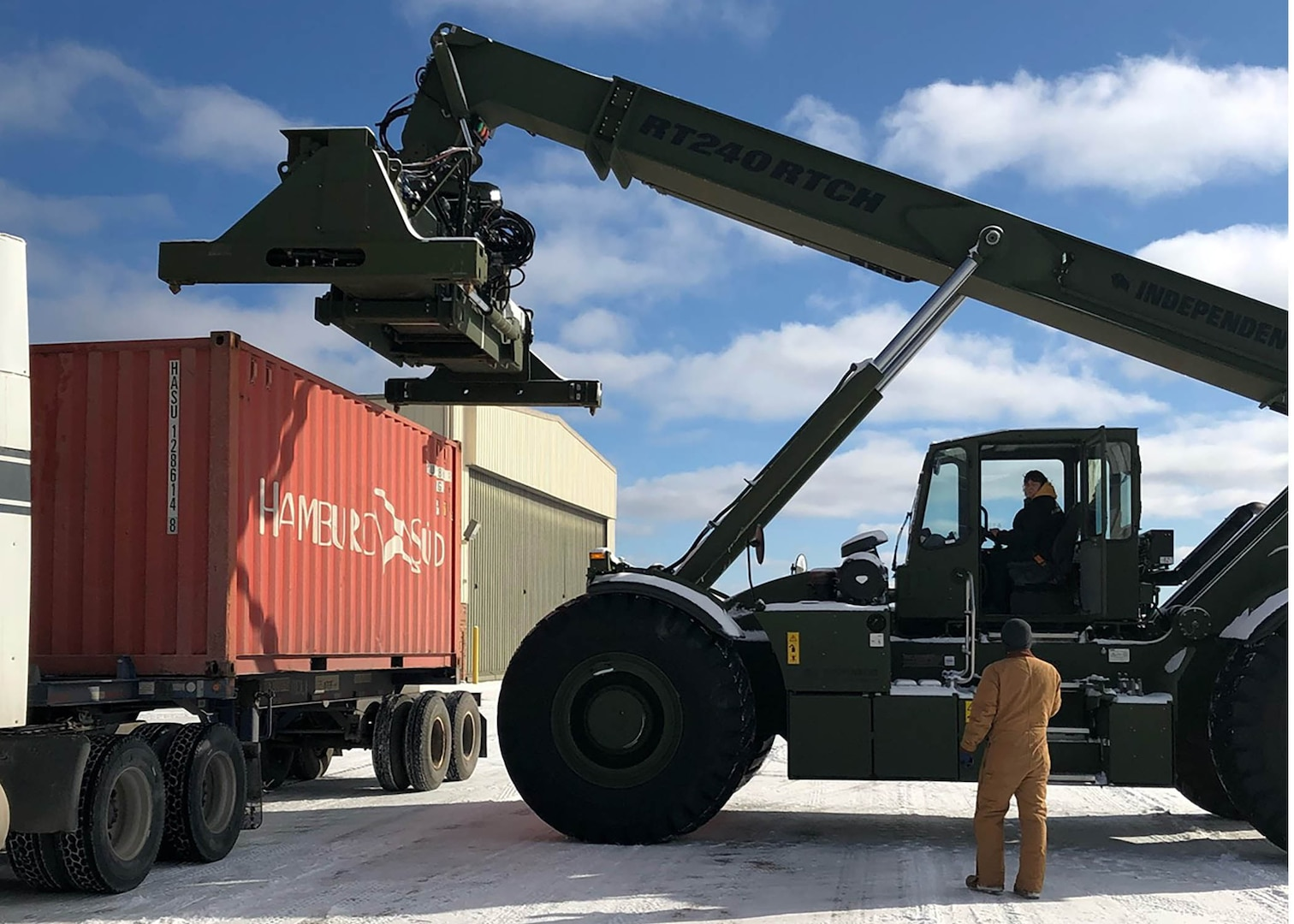 Teresa Cowell operates a rough terrain container handler to move a container that arrived Jan. 27 at the Battle Creek Michigan Air National Guard Base.