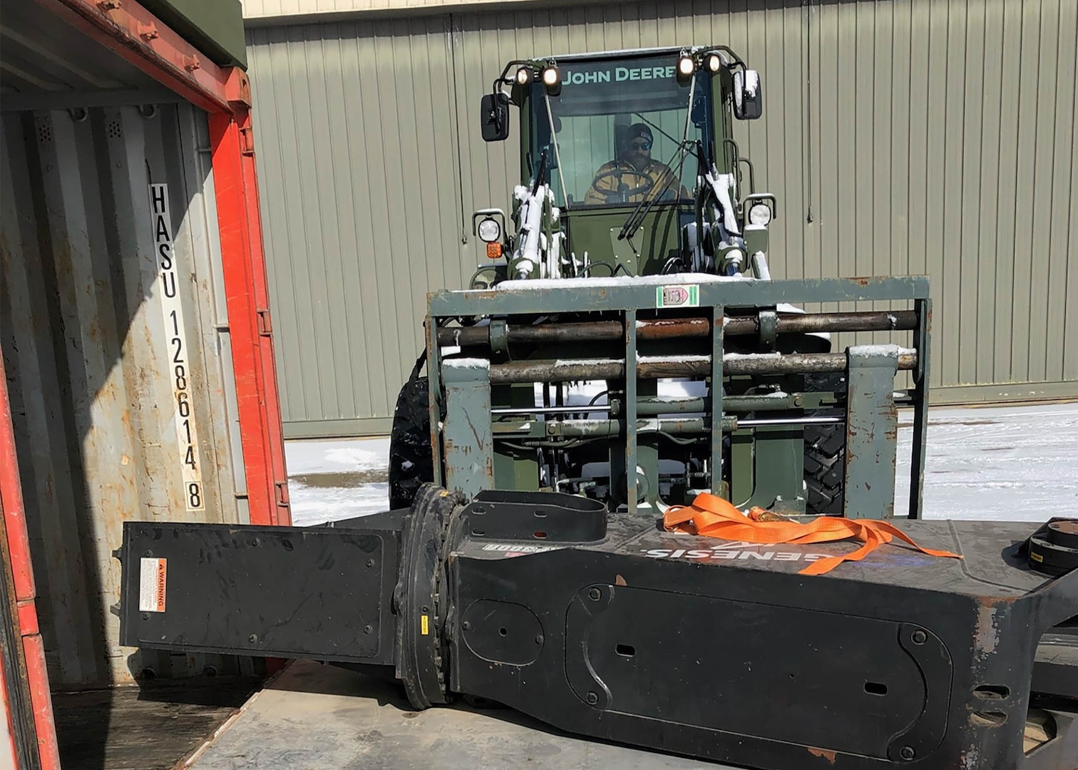Chris Milazzo operates a forklift bearing a shearing device fastened to an airlift pallet.
