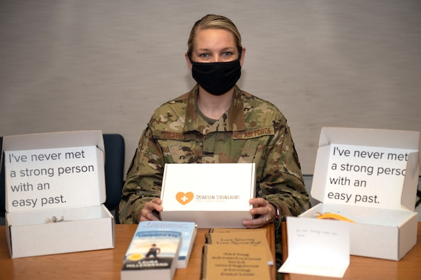 Tech. Sgt. Janna L. Ybarra, readiness noncommissioned officer, Airman and Family Readiness Center at Edwards Air Force Base, displays the contents of an Operation Strongheart kit, Jan. 28.