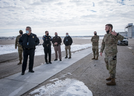Military members and civilian police tour the flight line at the Lincoln Air Port