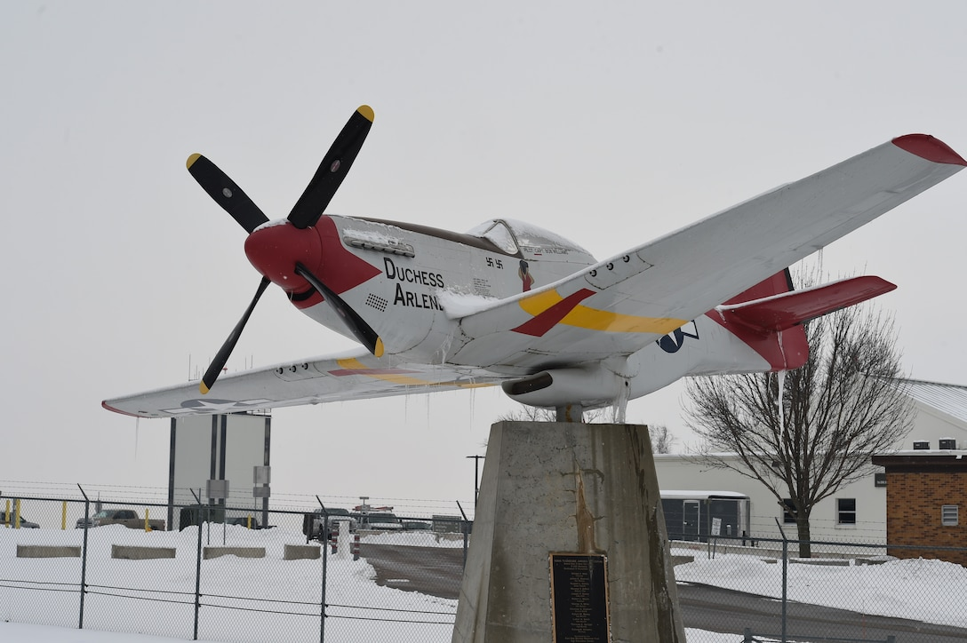 """The P-51 Mustang nicknamed """"Dutchess Arlene"""" currently stands outside the front gate of the 132d Wing in Des Moines, Iowa. The aircraft was dedicated to Iowa Tuskegee Airmen in 2002. (U.S. Air National Guard photo by Tech. Sgt. Michael J. Kelly)"""