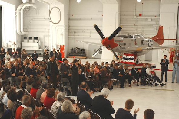Friends and family of Iowa's Tuskegee Airmen gather to witness the dedication of the 132d Wing's P-51 Mustang static display. (Courtesy photo)