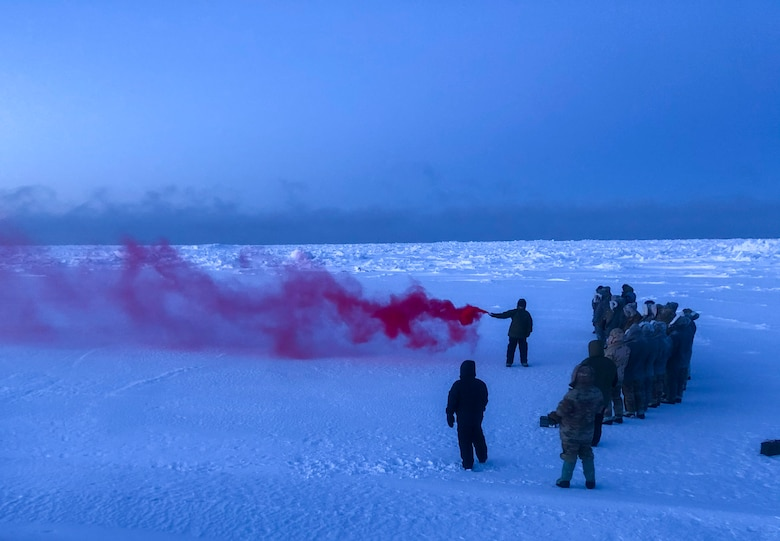 U.S. Air Force Staff Sgt. Samuel Ley, a 66th Training Squadron, Detachment 1 survival, evasion, resistance and escape (SERE) specialist, demonstrates how to use an MK-124 smoke and illumination signal on the Chukchi Sea Jan. 13, 2021.