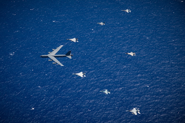 An 8-ship joint-coalition formation flies over Guam during exercise Cope North 21, near Andersen Air Force Base, Feb. 9, 2021.  Cope North is an annual exercise that serves as a keystone event to enhance U.S. relations with our regional allies and partners by demonstrating our resolve to promote security and stability throughout the Indo-Pacific.  (U.S. Air Force photo by Senior Airman Duncan C. Bevan)