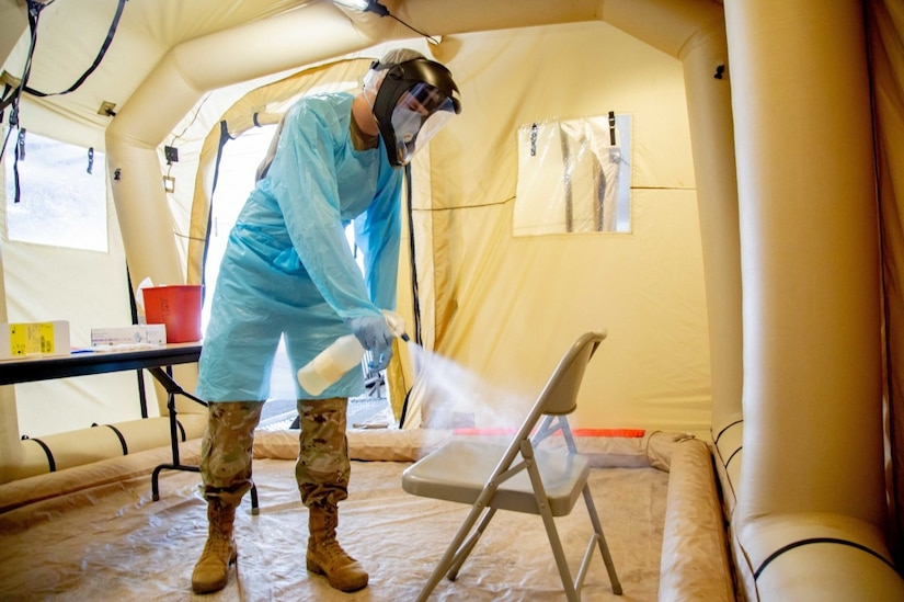 Army Pfc. Christopher Elsberry, assigned to the 36th Medical Company Area Support Battalion, sanitizes a chair inside the mobile COVID-19 testing unit at the Javits Center in New York City, May 19, 2020.