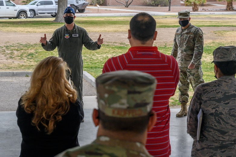 Col. Kevin Jamieson, 57th Wing vice commander talking to people