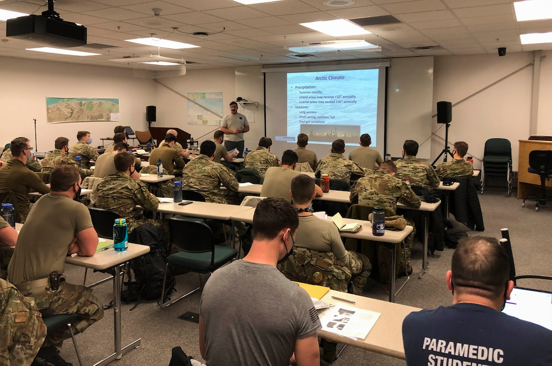Senior Airman Collin Stock, a 66th Training Squadron, Detachment 1 survival, evasion, resistance and escape, or SERE, specialist, teaches S-V81-C students about arctic survival at Utqiaġvik (Barrow), Alaska, Jan. 10, 2021. The S-V81-C course is designed for SERE specialists to expand their knowledge about the arctic environment and what is necessary to survive in the event of an emergency or deployment there.