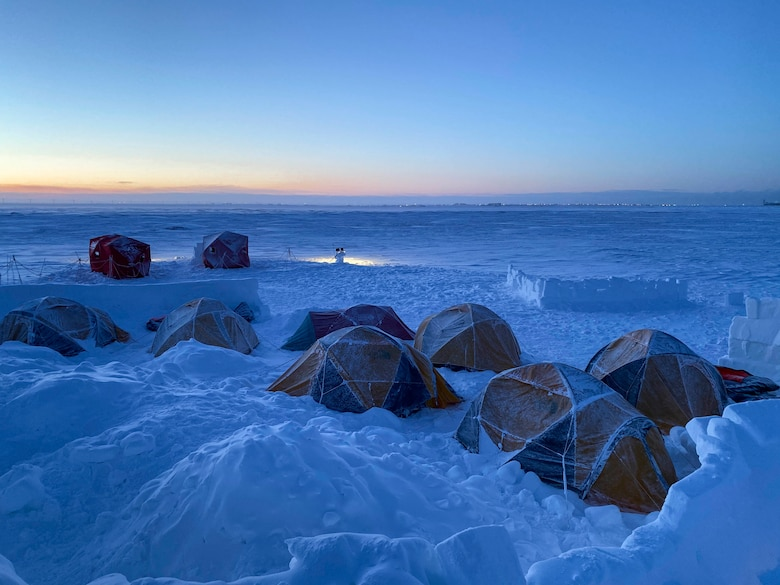 Tents line the snow during survival, evasion, resistance and escape, or SERE, training as specialists stay overnight at Utqiaġvik (Barrow), Alaska, Jan. 13, 2021. Prior to training in the Arctic environment, the SERE students trained in coastal, desert and tropical biomes around the world.