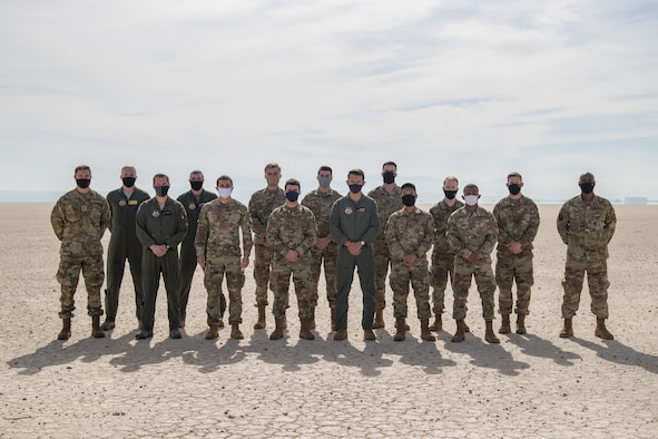 Airmen from Edwards Air Force Base, California, pose for a group photo on the Rogers Dry Lake Bed prior to their U.S. Space Force transfer ceremony, Feb. 11. (Air Force photo by Richard Gonzales)