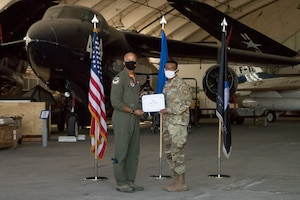 Airman Rashon Pradier, 412th Communications Squadron, originally of Lewisville, Texas, accepts his U.S. Space Force certificate from Col. Randel Gordon, 412th Test Wing Vice Commander, during a Space Force Transfer Ceremony at Edwards Air Force Base, California, Feb. 11. (Air Force photo by Richard Gonzales)