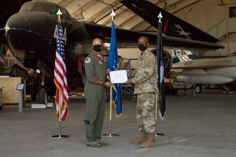 Master Sgt. Sheldon Newton, 412th Communications Squadron, originally of Watha, North Carolina, accepts his U.S. Space Force certificate from Col. Randel Gordon, 412th Test Wing Vice Commander, during a Space Force Transfer Ceremony at Edwards Air Force Base, California, Feb. 11. (Air Force photo by Richard Gonzales)