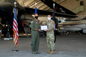 2nd Lt. Joshua Bonvisutto, Air Force Research Laboratory, originally of North Tonawanda, Ney York, accepts his U.S. Space Force certificate from Col. Randel Gordon, 412th Test Wing Vice Commander, during a Space Force Transfer Ceremony at Edwards Air Force Base, California, Feb. 11. (Air Force photo by Richard Gonzales)