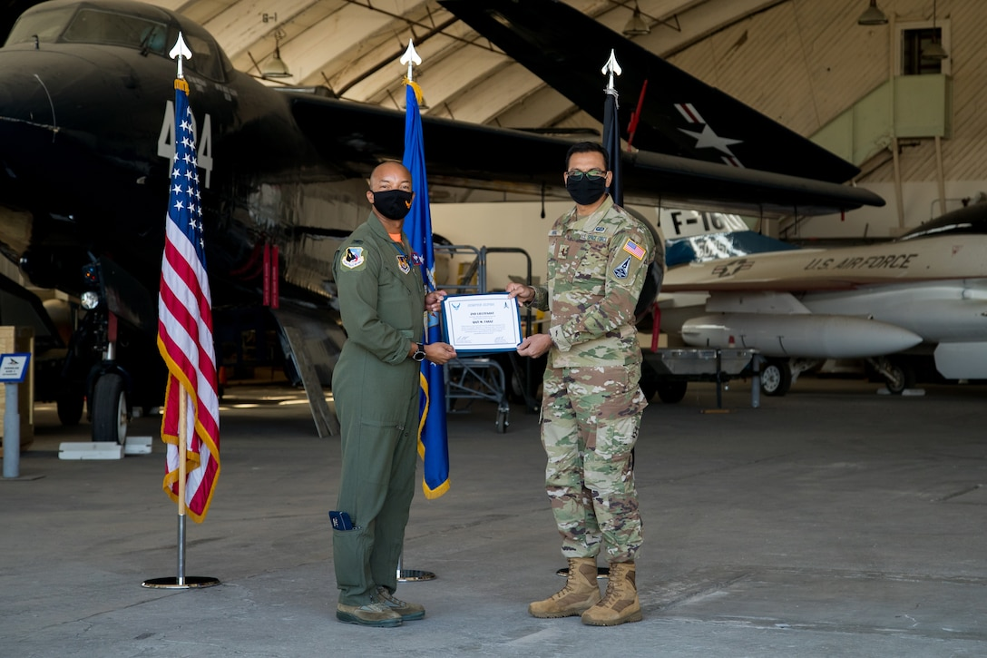 2nd Lt. Qazi Faraz, 773rd Test Squadron, originally of Houston, Texas, accepts his U.S. Space Force certificate from Col. Randel Gordon, 412th Test Wing Vice Commander, during a Space Force Transfer Ceremony at Edwards Air Force Base, California, Feb. 11. (Air Force photo by Richard Gonzales)