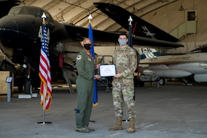 2nd Lt. Trevor Siniscalchi, Air Force Research Laboratory, originally of San Diego, California, accepts his U.S. Space Force certificate from Col. Randel Gordon, 412th Test Wing Vice Commander, during a Space Force Transfer Ceremony at Edwards Air Force Base, California, Feb. 11. (Air Force photo by Richard Gonzales)