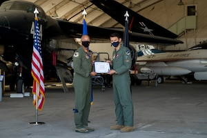 1st Lt. Luke Babich, 418th Flight Test Squadron, originally of Dix Hills, New York, accepts his U.S. Space Force certificate from Col. Randel Gordon, 412th Test Wing Vice Commander, during a Space Force Transfer Ceremony at Edwards Air Force Base, California, Feb. 11. (Air Force photo by Richard Gonzales)