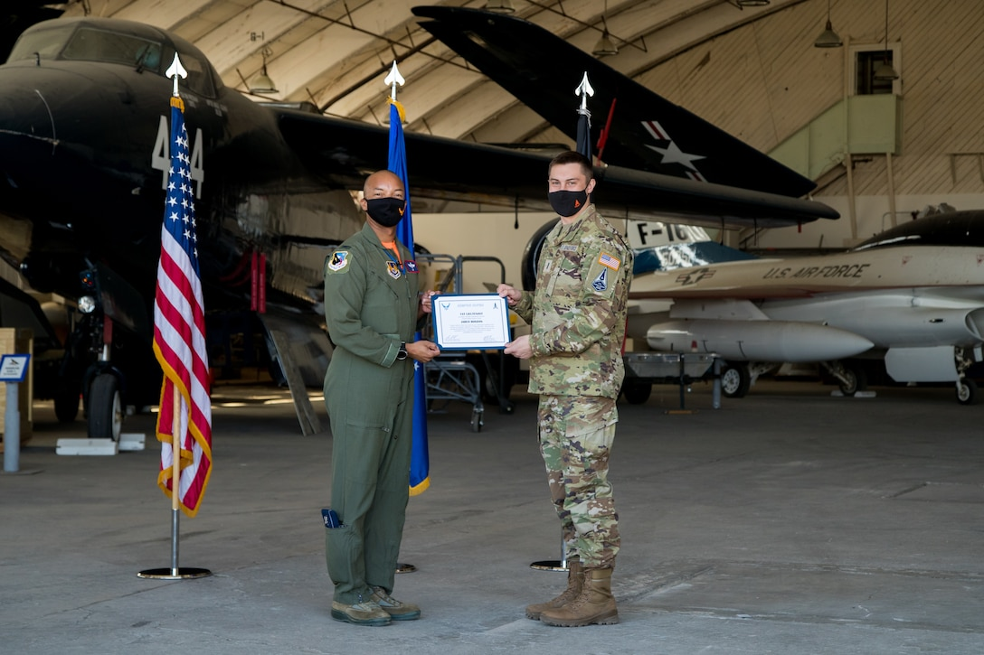 1st Lt. Jared Bogdan accepts his U.S. Space Force certificate from Col. Randel Gordon, 412th Test Wing Vice Commander, during a Space Force Transfer Ceremony at Edwards Air Force Base, California, Feb. 11. (Air Force photo by Richard Gonzales)