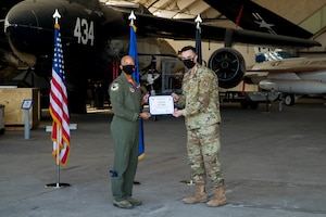 1st Lt. Cody Bronkar, 412th Communications Squadron, accepts his U.S. Space Force certificate from Col. Randel Gordon, 412th Test Wing Vice Commander, during a Space Force Transfer Ceremony at Edwards Air Force Base, California, Feb. 11. (Air Force photo by Richard Gonzales)