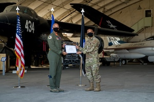 1st Lt. Kevin Lasquette, 772nd Test Squadron, originally from San Diego, California, accepts his U.S. Space Force certificate from Col. Randel Gordon, 412th Test Wing Vice Commander, during a Space Force Transfer Ceremony at Edwards Air Force Base, California, Feb. 11. (Air Force photo by Richard Gonzales)
