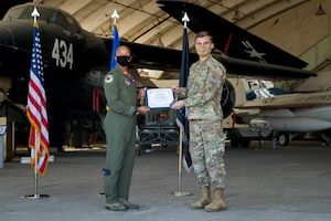 1st Lt. Lucas Schaper, Space Test Fundamentals Class 21-1, U.S. Air Force Test Pilot School, accepts his U.S. Space Force certificate from Col. Randel Gordon, 412th Test Wing Vice Commander, during a Space Force Transfer Ceremony at Edwards Air Force Base, California, Feb. 11. (Air Force photo by Richard Gonzales)