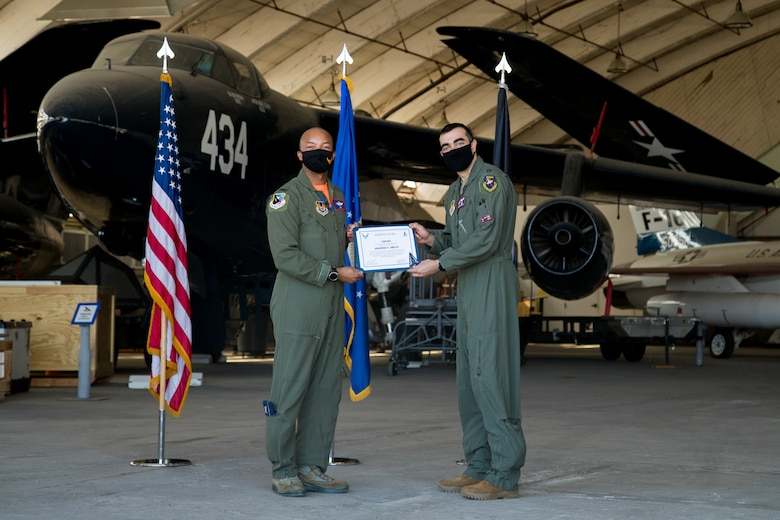 Capt. Jonathan Geerts, 419th Flight Test Squadron, originally of Berwyn, Pennsylvania, accepts his U.S. Space Force certificate from Col. Randel Gordon, 412th Test Wing Vice Commander during a Space Force Transfer Ceremony at Edwards Air Force Base, California, Feb. 11. (Air Force photo by Richard Gonzales)