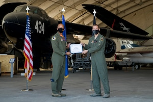 Capt. Kyle Hathaway, 461st Flight Test Squadron, originally of Portland, Oregon, accepts his U.S. Space Force certificate from Col. Randel Gordon, 412th Test Wing Vice Commander, during a Space Force Transfer Ceremony at Edwards Air Force Base, California, Feb. 11. (Air Force photo by Richard Gonzales)