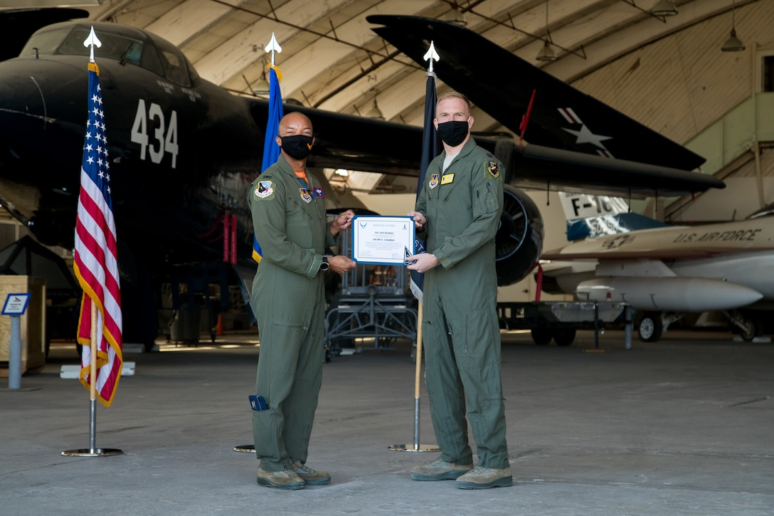 Capt. Jacob LaSarge, 452nd Flight Test Squadron, originally of Byron Center, Michigan, accepts his U.S. Space Force certificate from Col. Randel Gordon, 412th Test Wing Vice Commander during a Space Force Transfer Ceremony at Edwards Air Force Base, California, Feb. 11. (Air Force photo by Richard Gonzales)
