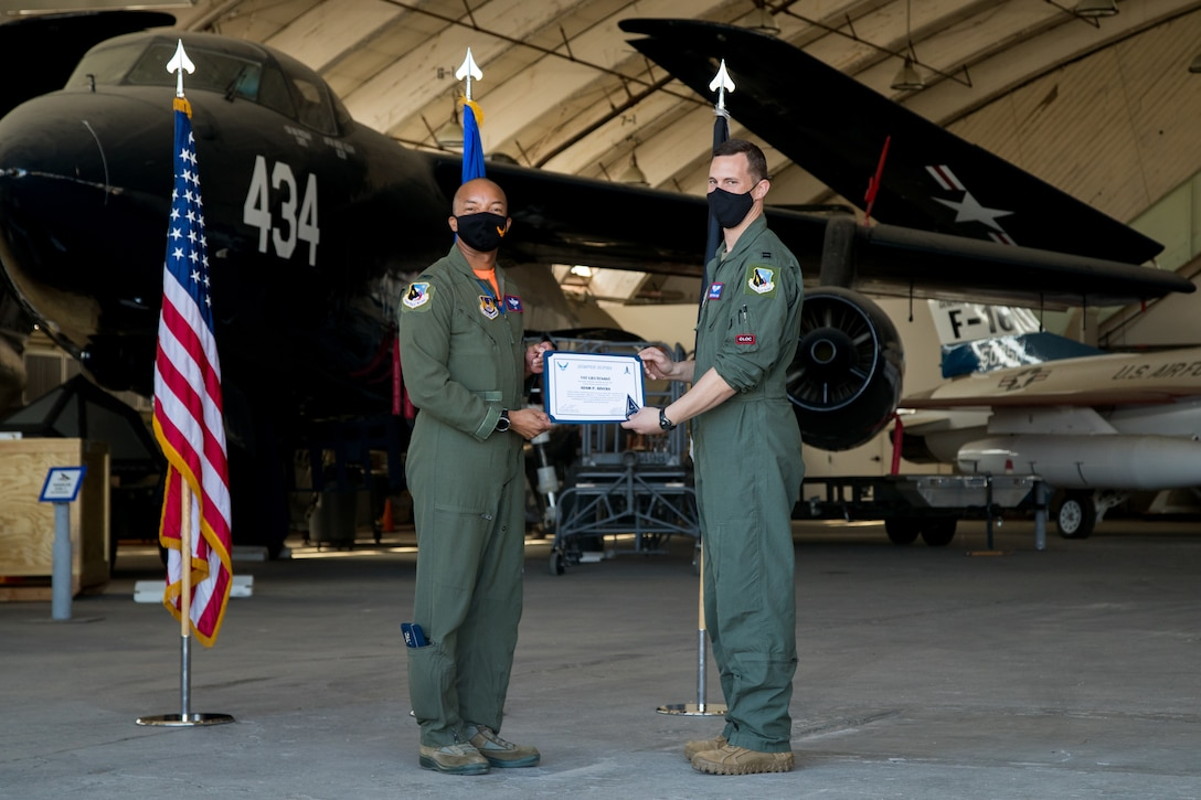 Capt. Christopher Reis, accepts his U.S. Space Force certificate from Col. Randel Gordon, 412th Test Wing Vice Commander, during a Space Force Transfer Ceremony at Edwards Air Force Base, California, Feb. 11. (Air Force photo by Richard Gonzales)