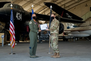 Capt. Karson Roberts, Air Force Research Laboratory, originally of Houston, Texas, accepts his U.S. Space Force certificate from Col. Randel Gordon, 412th Test Wing Vice Commander, during a Space Force Transfer Ceremony at Edwards Air Force Base, California, Feb. 11. (Air Force photo by Richard Gonzales)