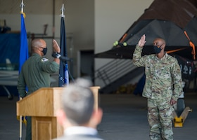 Master Sgt. Sheldon Newton, 412th Communications Squadron, originally of Watha, North Carolina, recites oath of enlistment during a Space Force Transfer Ceremony at Edwards Air Force Base, California, Feb. 11. (Air Force photo by Giancarlo Casem)