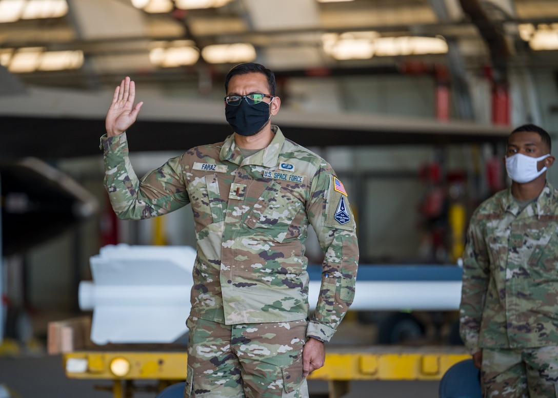 2nd Lt. Qazi Faraz, 773rd Test Squadron, originally of Houston, Texas, recites the oath of office during a Space Force Transfer Ceremony at Edwards Air Force Base, California, Feb. 11. (Air Force photo by Giancarlo Casem)
