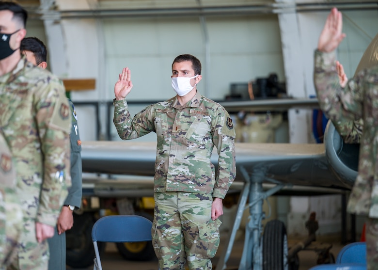 2nd Lt. Joshua Bonvisutto, Air Force Research Laboratory, originally of North Tonawanda, Ney York, recites the oath of office during a Space Force Transfer Ceremony at Edwards Air Force Base, California, Feb. 11. (Air Force photo by Giancarlo Casem)