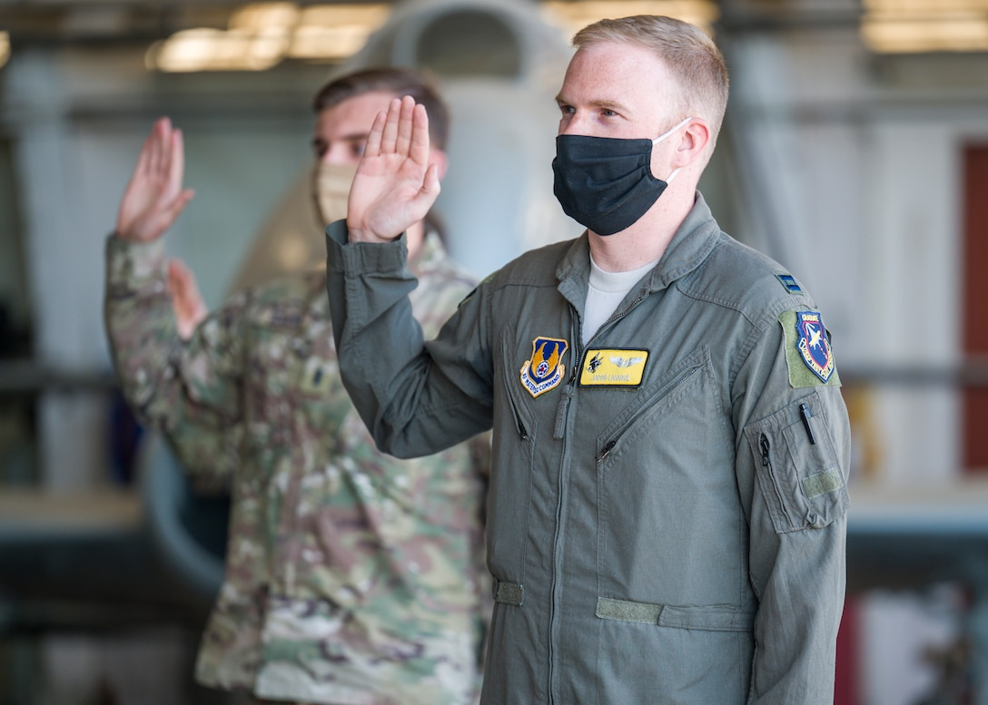 Capt. Jacob LaSarge, 452nd Flight Test Squadron, originally of Byron Center, Michigan, recites the oath of office during a Space Force Transfer Ceremony at Edwards Air Force Base, California, Feb. 11. (Air Force photo by Giancarlo Casem)