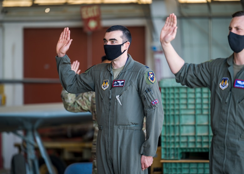 Capt. Jonathan Geerts, 419th Flight Test Squadron, originally of Berwyn, Pennsylvania, recites the oath of office during a Space Force Transfer Ceremony at Edwards Air Force Base, California, Feb. 11. (Air Force photo by Giancarlo Casem)